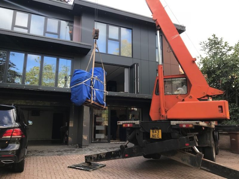 If we can't get them up the stairs...... then in comes the Crane !: Swipe To View More Images